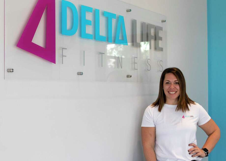 Delta Fitness franchise owner Jessica Hollaway poses near the front entrance of Delta Fitness on Tuesday, November 5, 2019 in Conroe Photo: Cody Bahn, Houston Chronicle / Staff Photographer / © 2019 Houston Chronicle