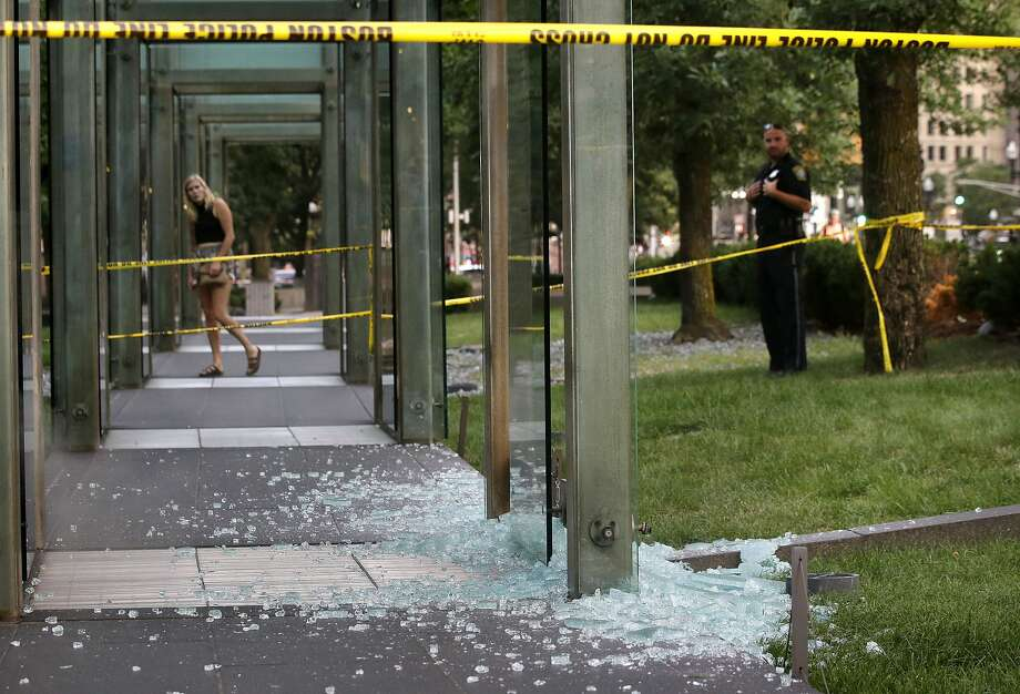 Shattered glass lies on the ground at the New England Holocaust Memorial in Boston after the tribute was smashed by vandals in 2017. Memorials around the country are repeatedly attacked. Photo: Steven Senne / Associated Press 2017