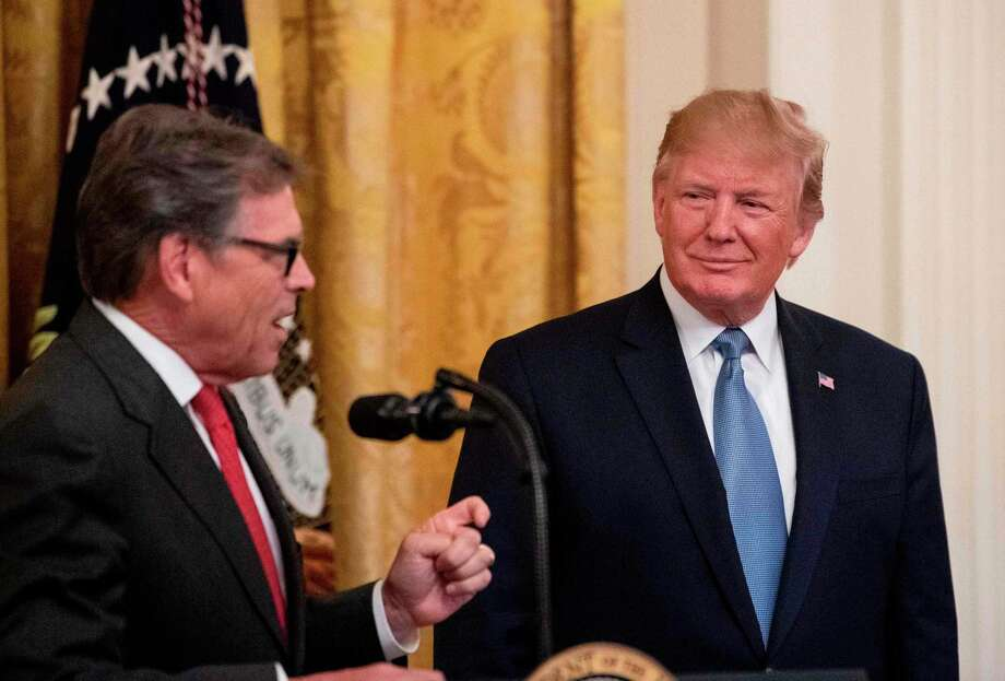 US President Donald Trump listens as Energy Secretary Rick Perry speaks about the administration's environmental policies at the White House in Washington, DC on July 8, 2019. (Photo by NICHOLAS KAMM / AFP)NICHOLAS KAMM/AFP/Getty Images Photo: NICHOLAS KAMM / Nicholas Kamm/AFP/Getty Images / AFP or licensors
