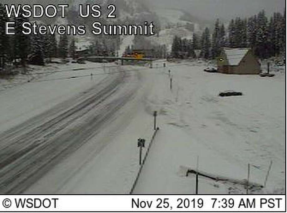 Snow was visible on Stevens Pass Monday morning. Traction tires were required. Photo: Courtesy WSDOT