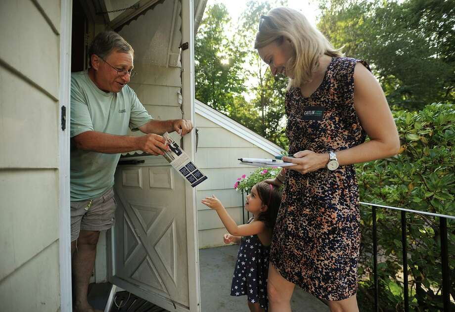 Rich Jacobs, of Fairfield, is handed campaign literature by Parker Pereira, 3, daughter of candidate for Fairfield state representative Caitlin Clarkson Pereira, during an afternoon of campaigning on Limerick Road in Fairfield, Conn. on Wednesday, August 22, 2018. Clarkson Pereira was denied her request to the State Elections Enforcement Commission to use her campaign funds to pay for child care. Photo: Brian A. Pounds / Hearst Connecticut Media / Connecticut Post