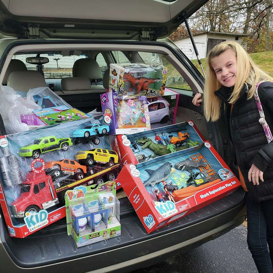 Faith Tremblay at The Edge Fitness Clubs Shelton last week picking up new unwrapped toys for YNHCH Toy Closet that people donated for Faith's annual toy drive. Photo: Contributed Photo / Connecticut Post