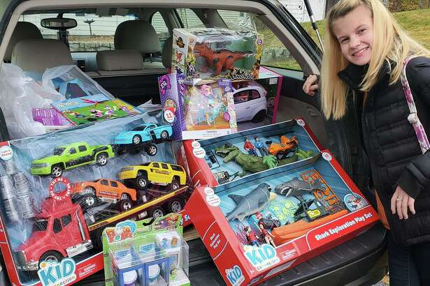 Faith Tremblay at The Edge Fitness Clubs Shelton last week picking up new unwrapped toys for YNHCH Toy Closet that people donated for Faith's annual toy drive.