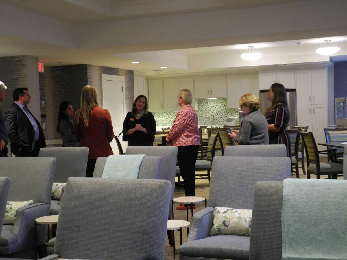 Wilton officials including Selectman Josh Cole, left, Selectwoman Deborah McFadden, third from right, and First Selectwoman Lynne Vanderslice, second from right, listen to Kristen Heuman, regional director of operations, give a tour of the Sunrise Senior Living facility in Wilton on Nov. 21.