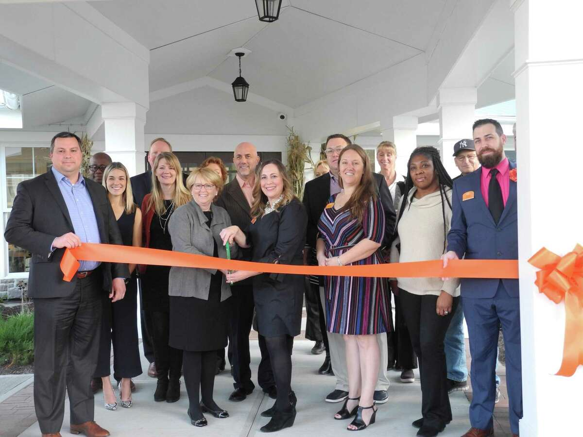 At the Sunrise Senior Living ribbon cutting celebration on Nov. 21 are, from left, Selectman Josh Cole, First Selectwoman Lynne Vanderslice, Kristen Heuman, regional director of operations, executive director Melissa Adams, and Dylan Eckstein, associate director of sales, at right.