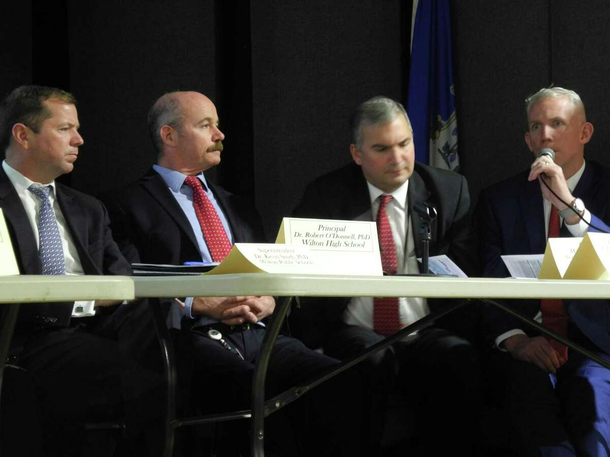 At the vaping forum on Nov. 21 at Trackside Teen Center in Wilton are, from left, Wilton Superintendent of Schools Kevin Smith, Wilton High School Principal Robert O'Donnell, New Canaan Superintendent of Schools Bryan Luizzi, and New Canaan High School Principal William D. Egan.
