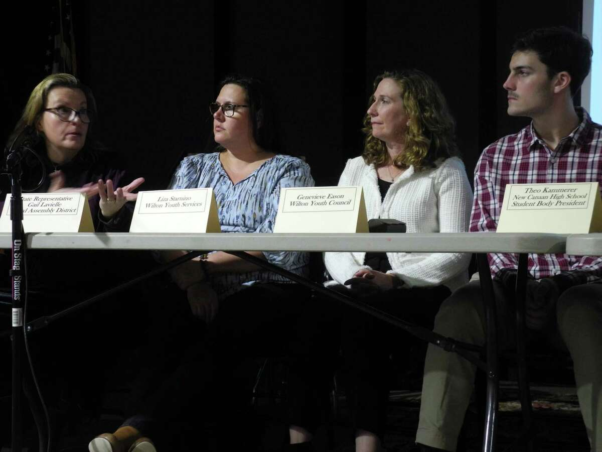 At the vaping forum on Nov. 21 at Trackside Teen Center in Wilton are, from left, Liz Jorgensen of Insight Counseling, Lisa Starnino of Wilton Youth Services, Genevieve Eason of Wilton Youth Council, and Theo Kammerer, New Canaan High School student body president.