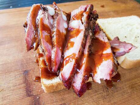 The Rib sandwich is a signature dish at Burns Original BBQ.