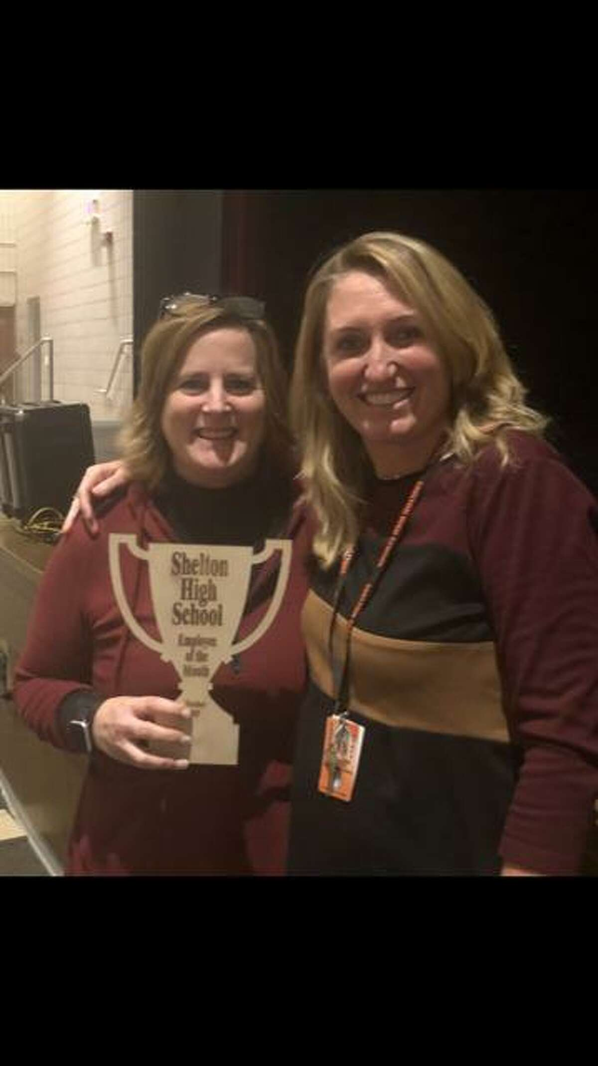 Lynn Coffin, Shelton High employee of the month, with interim Principal Kathy Riddle.