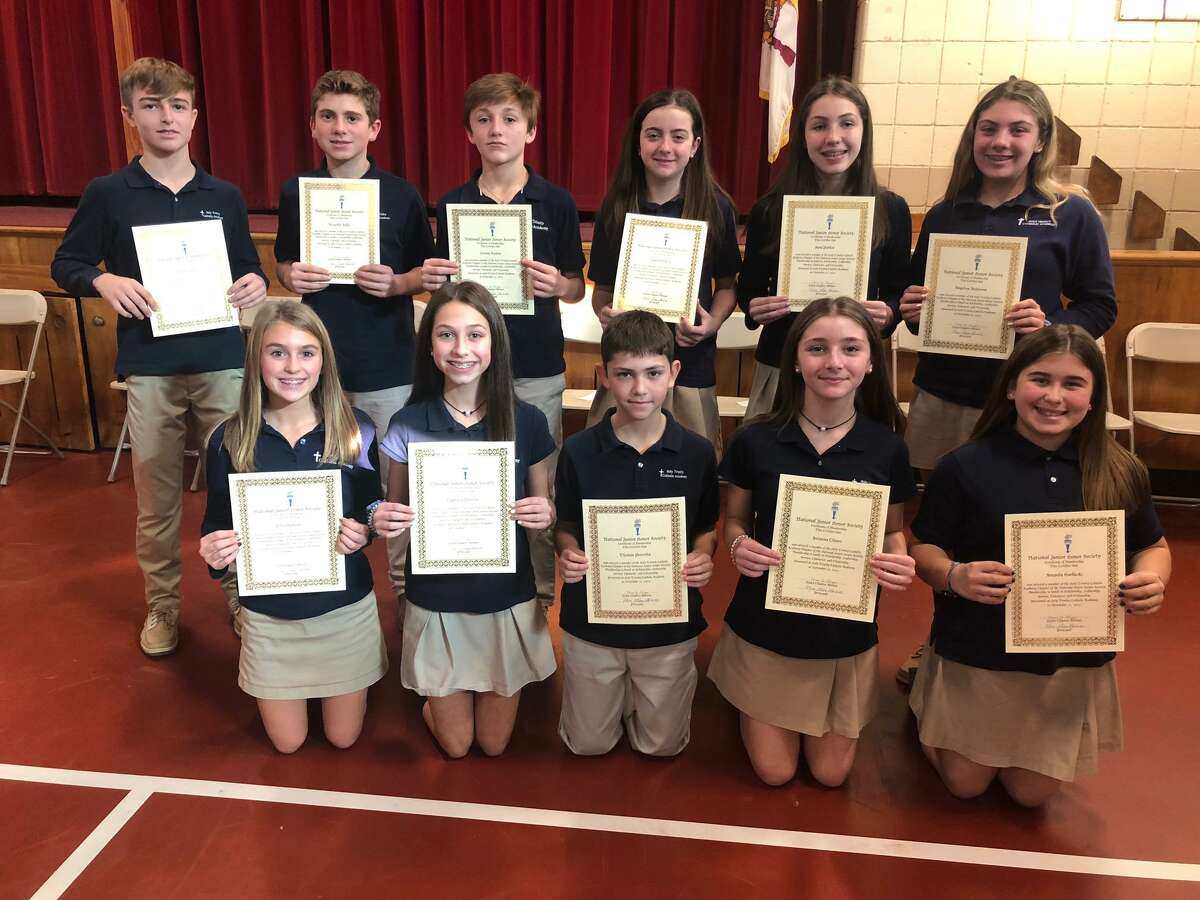 Eleven students at Holy Trinity Catholic Academy were inducted into the National Junior Honor Society Thursday, Nov. 21.