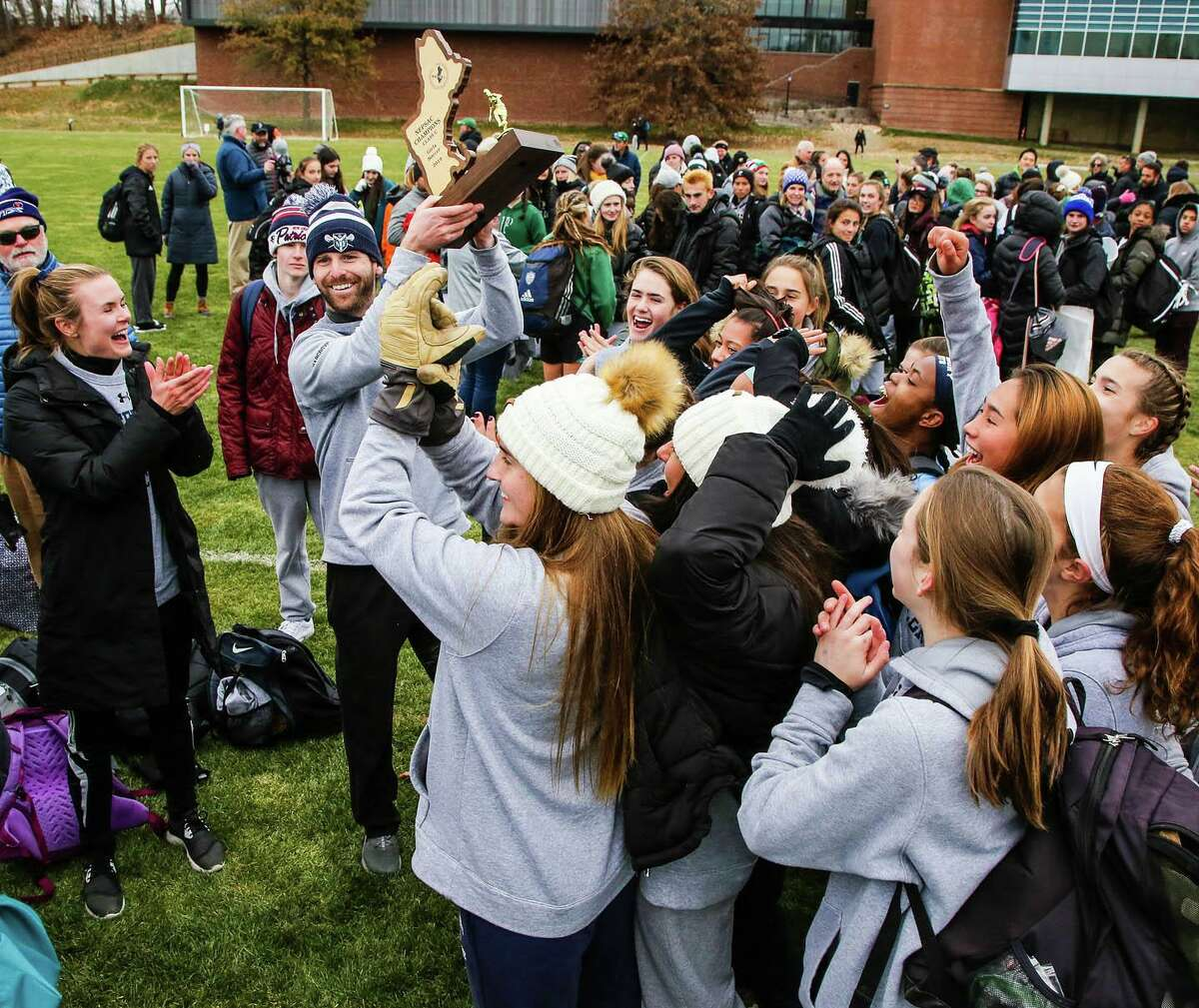 Canterbury School girls' varsity soccer recently won the Class C Title in the New England Private School Athletic Council (NEPSAC) Championship Final. Head Coach Sam Hargrove and his team proudly hold up the trophy.