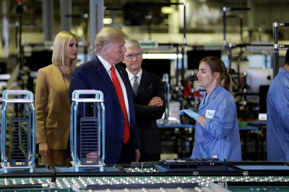 President Donald Trump speaks during a tour of an Apple manufacturing plant, Wednesday, Nov. 20, 2019, in Austin, as Rep. John Carter, R-Texas, left, looks on. (AP Photo/ Evan Vucci) Photo: Evan Vucci, STF / Associated Press / Copyright 2019 The Associated Press. All rights reserved