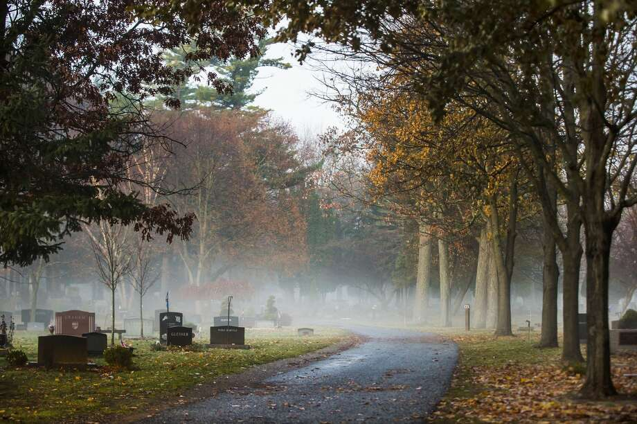 A blanket of fog covers the ground Monday, Nov. 25, 2019 at Midland Cemetery. (Katy Kildee/kkildee@mdn.net) Photo: (Katy Kildee/kkildee@mdn.net)