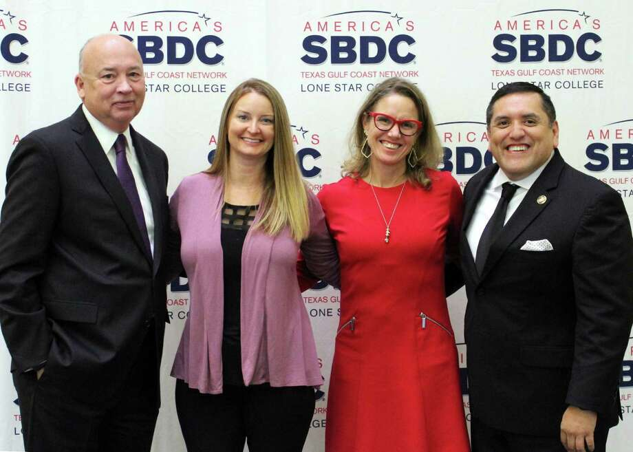 The Lone Star College Small Business Development Center recognized its 2019 Small Business of the Year Award winners. Shown (left - right) are Stephen C. Head, Ph.D., LSC chancellor; Heather Washburn, district director for U.S. Rep. Kevin Brady; Valerie Maher, lead economic development specialist, Houston U.S. Small Business Administration; and Miguel Lopez, LSC SBDC executive director. Photo: Courtesy Photo