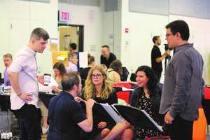 Jennifer Lee, center, with the Disney creative team working on the original Frozen movie screenplay (Provided photo)