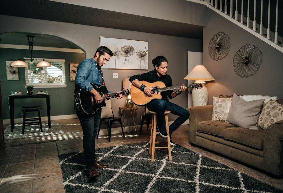 "Along with the glossy staging photos of the home — located at 8479 Timber Belt — showcasing the updated kitchen, plush backyard and spacious bedrooms, are portraits of Chris Perez, the husband of the late Tejano legend Selena and former guitarist of ""Los Dinos."" Photo: Dillon Kirk"