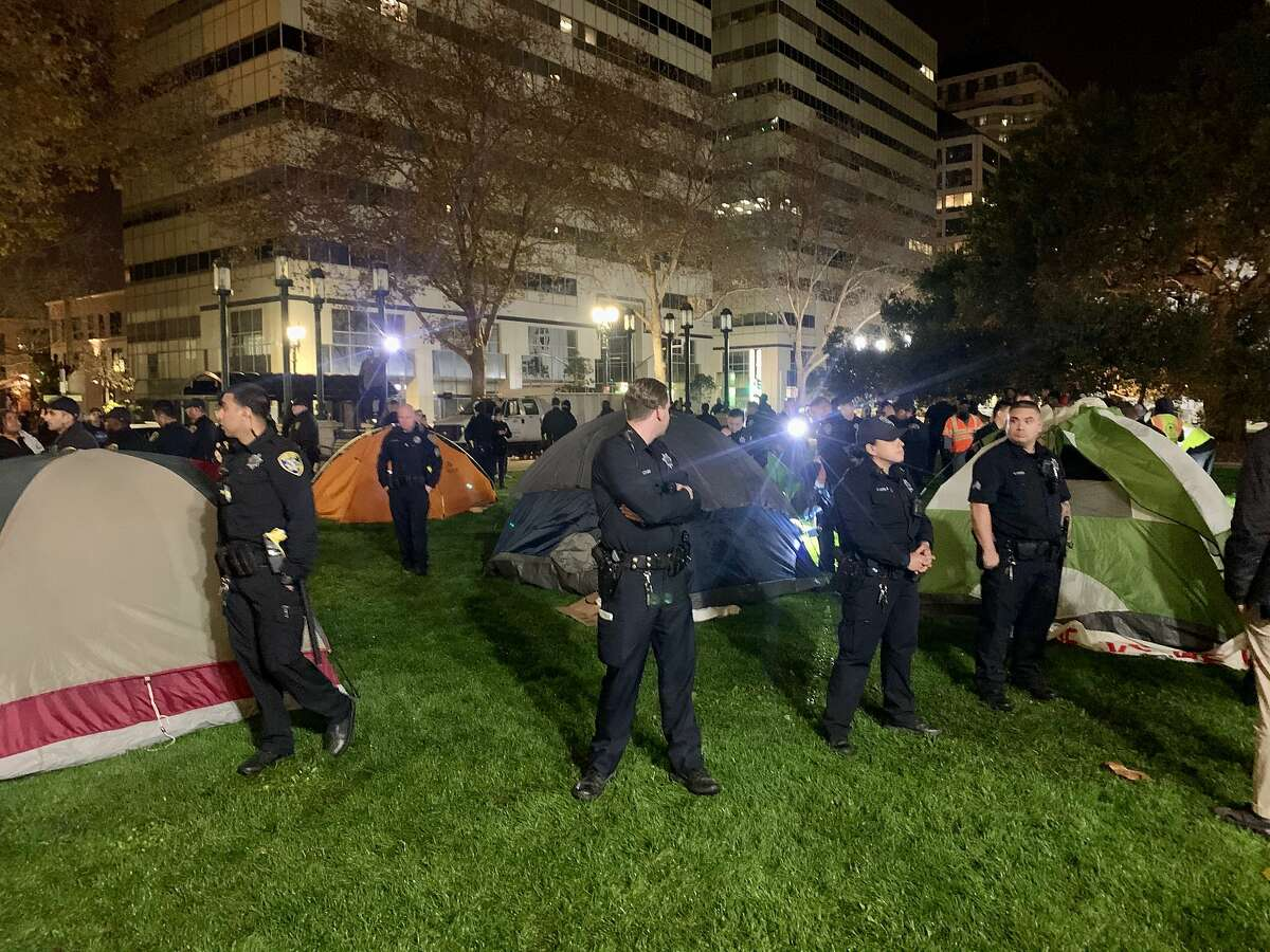 Several dozen people gathered outside Oakland City Hall Sunday to protest the city's homeless solutions and called for more housing. At least 19 people were arrested.