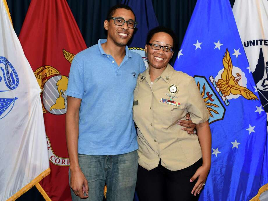 Christopher Delaney, of Houston, joined America's Navy during an enlistment ceremony held at the San Antonio Military Entrance Processing Station.  Delaney, who will served in the aviation ordnance (AO) career field, is married to Personnel Specialist 1st Class Kamitria Delaney (right) assigned to Navy Recruiting District (NRD) San Antonio. Photo: Photo By Burrell Parmer, Public Affairs Officer / U.S. Navy