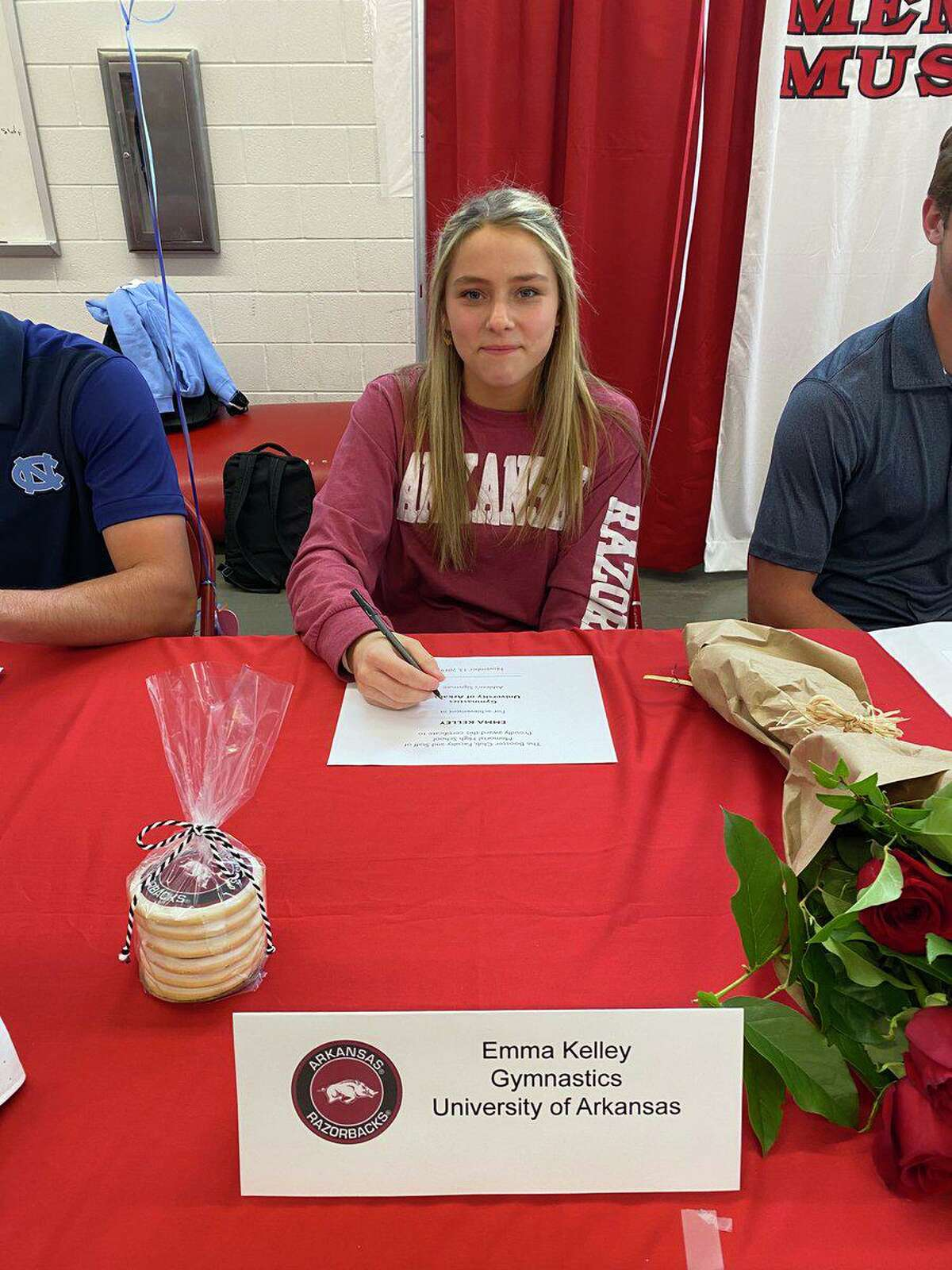 Memorial senior Emma Kelley signed a National Letter of Intent to attend and compete in gymnastics at the University of Arkansas.