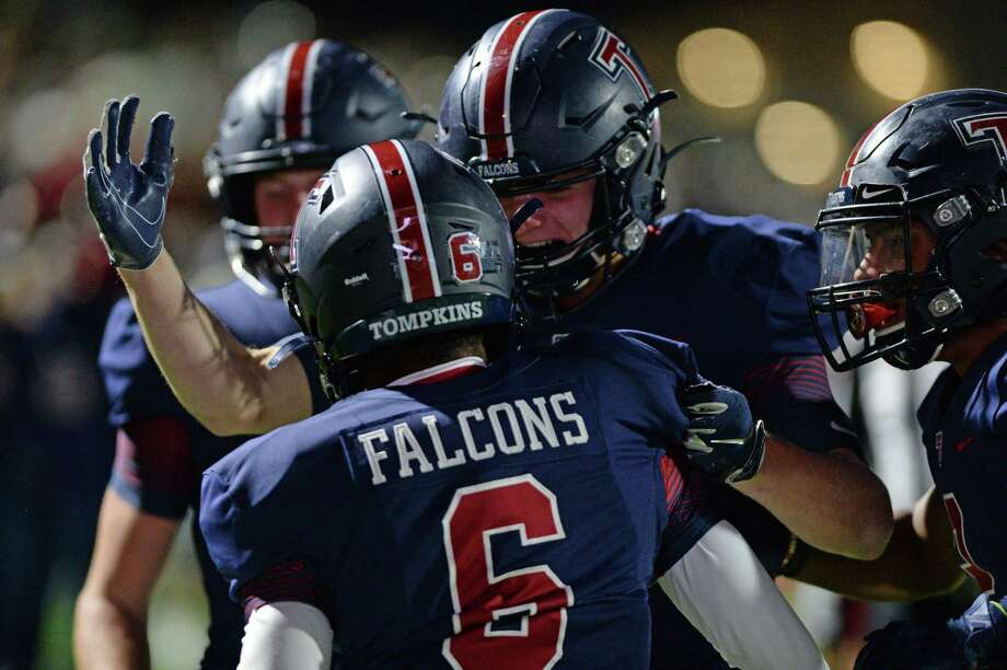 The Tompkins football team celebrates a first-quarter touchdown run by Marquis Shoulders (6). The Falcons defeated Cypress Falls, 30-27 in overtime, in the Class 6A Division I area playoffs Nov. 22 at Legacy Stadium. Photo: Craig Moseley, Houston Chronicle / Houston Chronicle / ©2019 Houston Chronicle