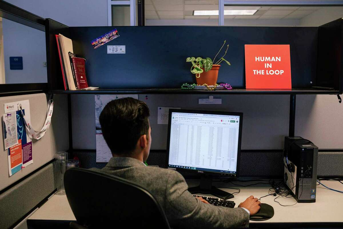 Oscar Cabezas works at his desk in the office of iMerit, a technology services company, in New Orleans, May 6, 2019. Tech executives rarely discuss the labor-intensive process that goes into the creation of artificial intelligence, which is learning from thousands of office workers around the world. (Bryan Tarnowski/The New York Times)