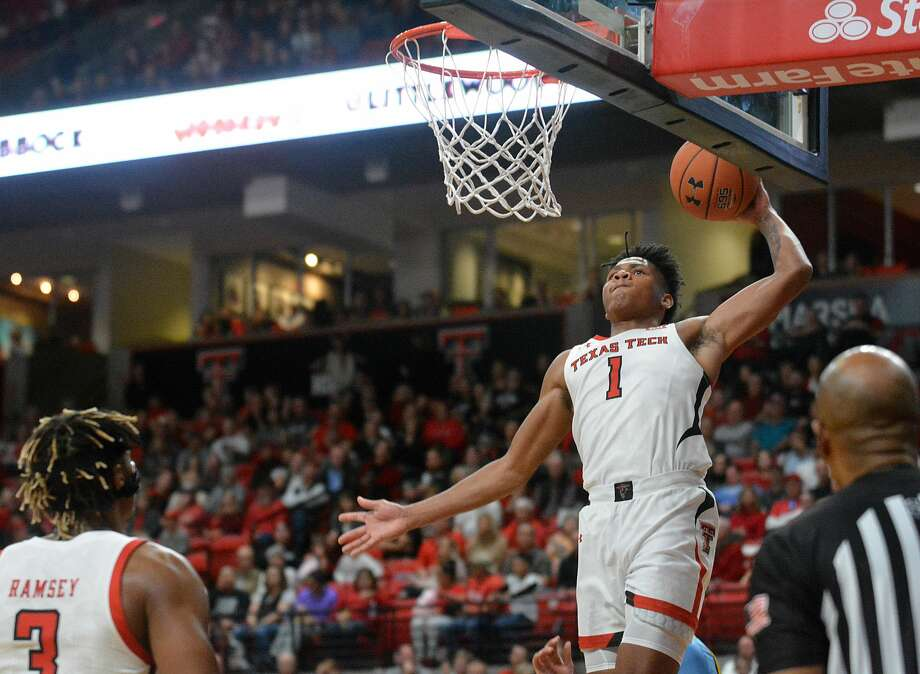 Texas Tech freshman Terrence Shannon Jr. rises for a slam dunk as fellow freshman Jahmi'us Ramsey looks on during their NCAA men's basketball game against Long Island on Sunday afternoon in the United Supermarkets Arena. Photo: Nathan Giese/Planview Herald