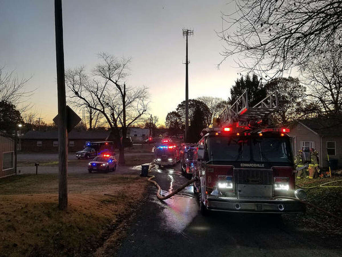 Emergency vehicles fill Second Avenue Monday as Edwardsville and Glen Carbon fire crews work to extinguish a residential fire.