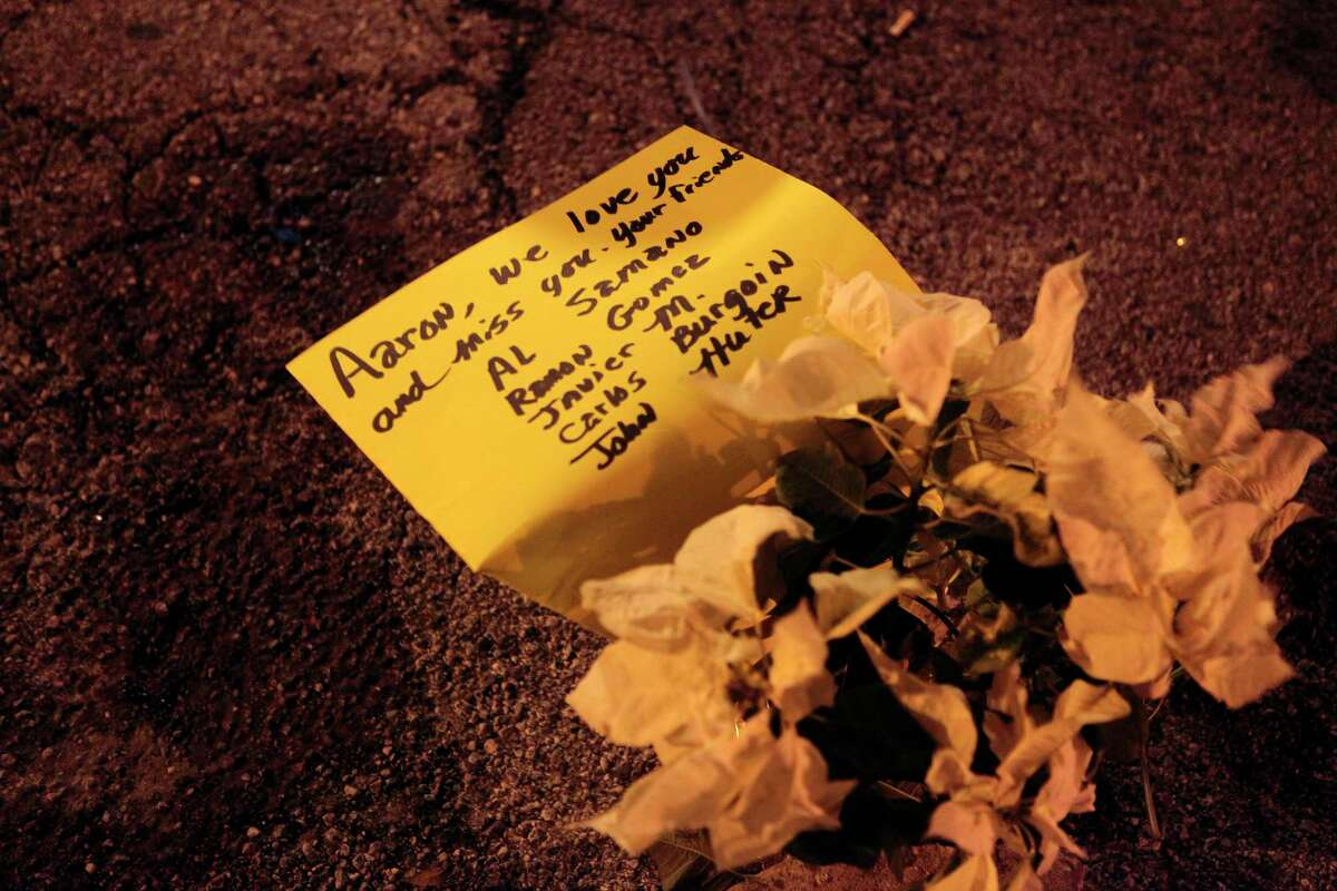 Flowers and a note were set up as a memorial to 28-year-old Aaron Scheerhorn after he was fatally stabbed December 11, 2010 at Club Blur in the Montrose area of Houston, Texas.
