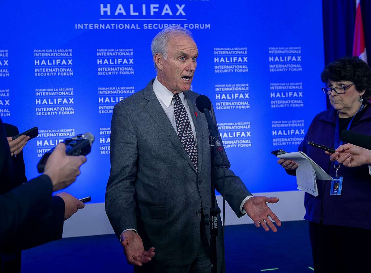 In this Saturday, Nov. 23, 2019 photo, U.S. Navy Secretary Richard Spencer fields questions at a media availability at the Halifax International Security Forum in Halifax, Nova Scotia. U.S. Defense Secretary Mark Esper has fired the Navy's top official over his handling of the case of a SEAL accused of war crimes who President Donald Trump has defended. Esper said on Sunday, Nov. 24 that he had lost confidence in Spencer and alleged that Spencer proposed a deal with the White House behind his back to resolve the SEAL's case. (Andrew Vaughan/The Canadian Press via AP)