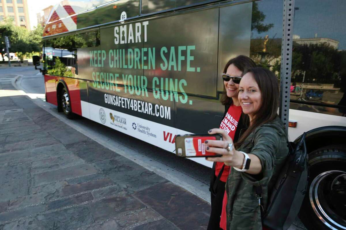 Anna Kehde, left, and Jamie Ford, with Mothers Demand Action for Gun Sense in America, on Monday take a selfie in front of a VIA bus advertising a gun safety campaign.Bexar County Judge Nelson Wolff and Sheriff Javier Salazar announced the campaign that will include public education and the distribution of thousands of gun locks. Also involved in the campaign is University Health System.