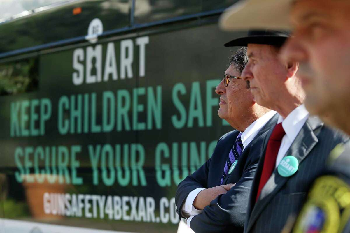 University Health Systems CEO and President George B. Hernandez, left, joins Bexar County Judge Nelson Wolff and Sheriff Javier Salazar to announce a gun safety campaign Monday, Nov. 25, 2019.