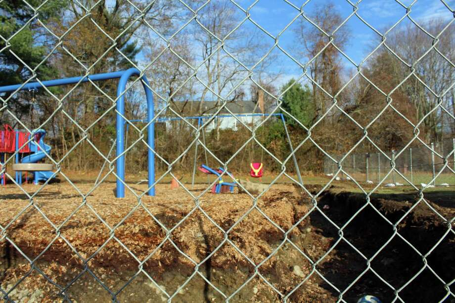 This weekend, contractors dug up the contaminated wood framings and surrounding soil at Jennings Elementary School's two playgrounds. Photo: Rachel Scharf / Hearst Connecticut Media