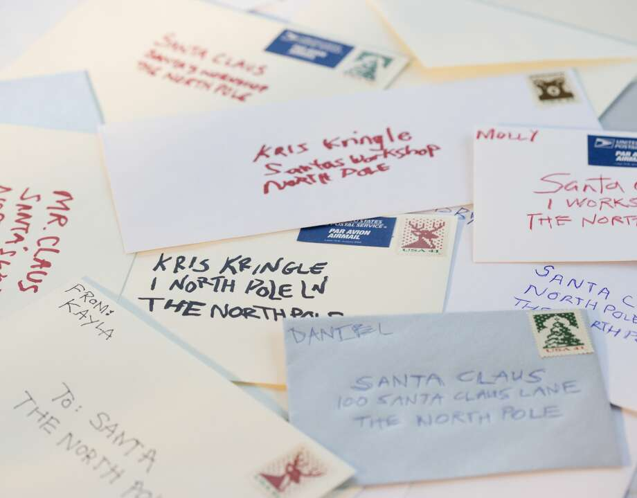 """The United States Postal Service is asking for volunteers to help take a load off Santa's sleigh and """"adopt"""" letters from underprivileged children as part of its """"Operation Santa"""" initiative. Photo: Getty Images"""
