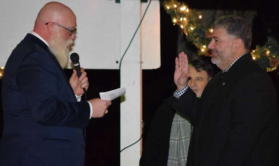 Spectrum/Pete Bass, right, is sworn into office as mayor of New Milford by State Rep. Bill Buckbee at a Nov. 30, 2017, swearing-in ceremony held at the bandstand on the Village Green in New Milford. Other elected officials were also sworn in. Photo: Deborah Rose / Hearst Connecticut Media / The News-Times  / Spectrum