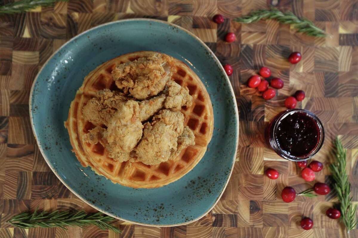 Leftover turkey gets country fried and placed on top of waffles with cranberry maple syrup in this unique day-after-Thanksgiving recipe.