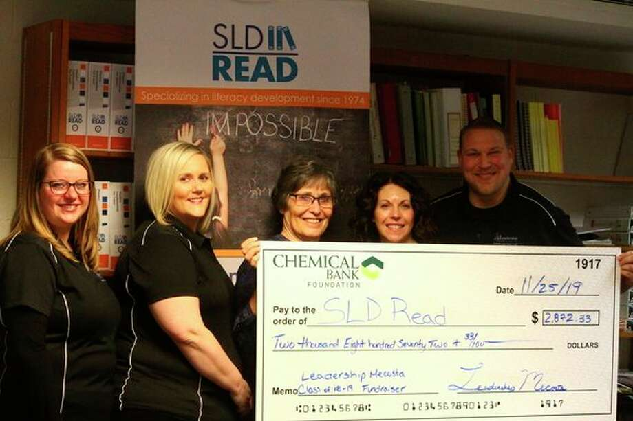 The Mecosta Leadership class of 2019 presented SLD Read with a check for more than $2,000 Monday. Pictured are class members, Katelynn Johnson, Katie Wayne, Heidi Kinally and Josh Pyles, along with SLD Read director Suzanne Finney. (Pioneer photo/Catherine Sweeney)