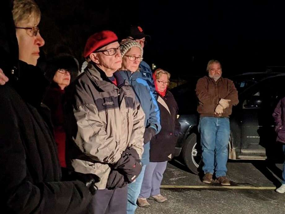 Participants at Onekama's Celebration of Lights listen as Beth McCarthy reads names of those honored and remembered on Sunday. (Courtesy photo)
