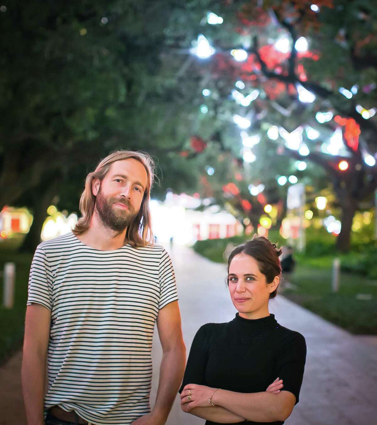 """Artists Arnaud Giroud of Pitaya, based in Lyon, France; and Houston artist Lina Dib collaborated to create """"Paloma,"""" this year's holiday sound and light installation along the oak allee at Discovery Green, sponsored by PNC Bank."""
