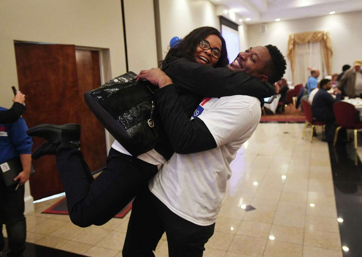 Ganim supporters Karline Victor and Rev. Herron Gaston hug after hearing the news of the Bridgeport mayor's re-election at Testo's Restaurant in Bridgeport, Conn. on Tuesday, November 5, 2019.