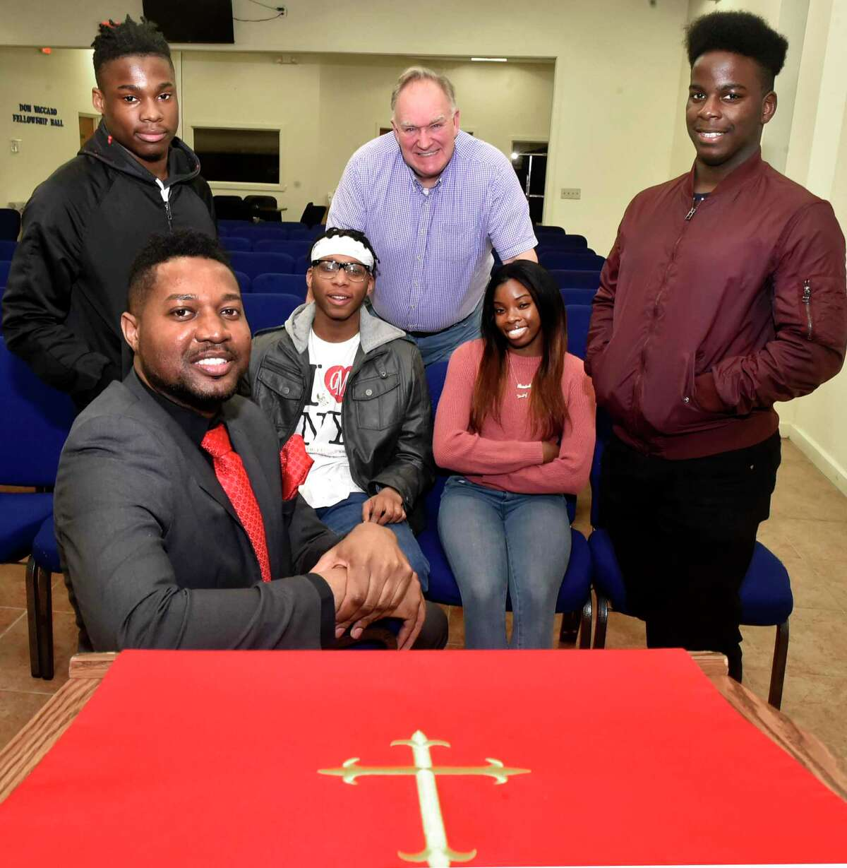 Reverend Herron Gaston, Yale Divinity School Associate Director of Admissions and Recruitment and Senior Pastor at Summerfield United Methodist Church in Bridgeport, sitting front, who organized Youth With A Purpose, sitting with participants.