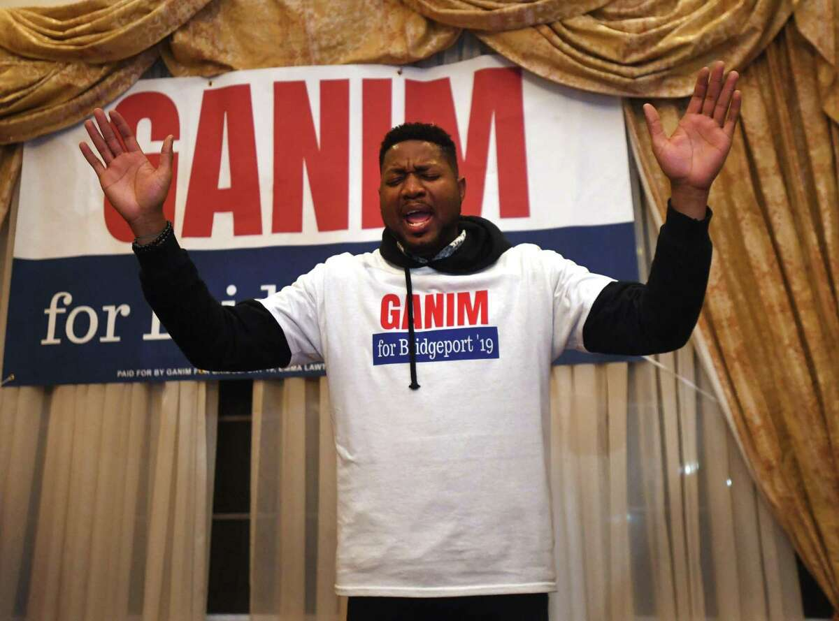Ganim supporter Rev. Herron Gaston says a prayer before the Bridgeport mayor is introduced for his victory speech at Testo's Restaurant in Bridgeport, Conn. on Tuesday, November 5, 2019.