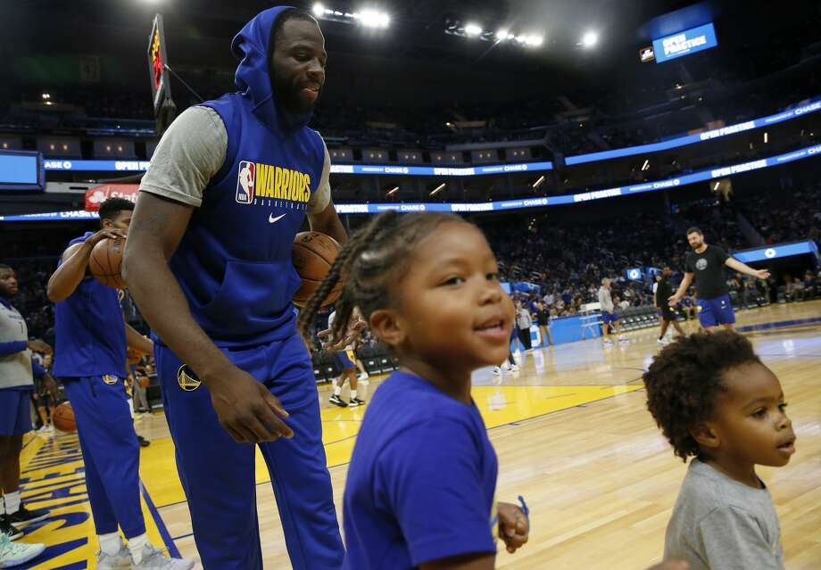 Golden State Warriors' Draymond Green takes part in an open practice as his stepdaughter Olive, 4, and son D.J. 2, head to the sideline at the Chase Center in San Francisco on Oct. 7, 2019. Photo: MediaNews Group/The Mercury News/MediaNews Group Via Getty Images