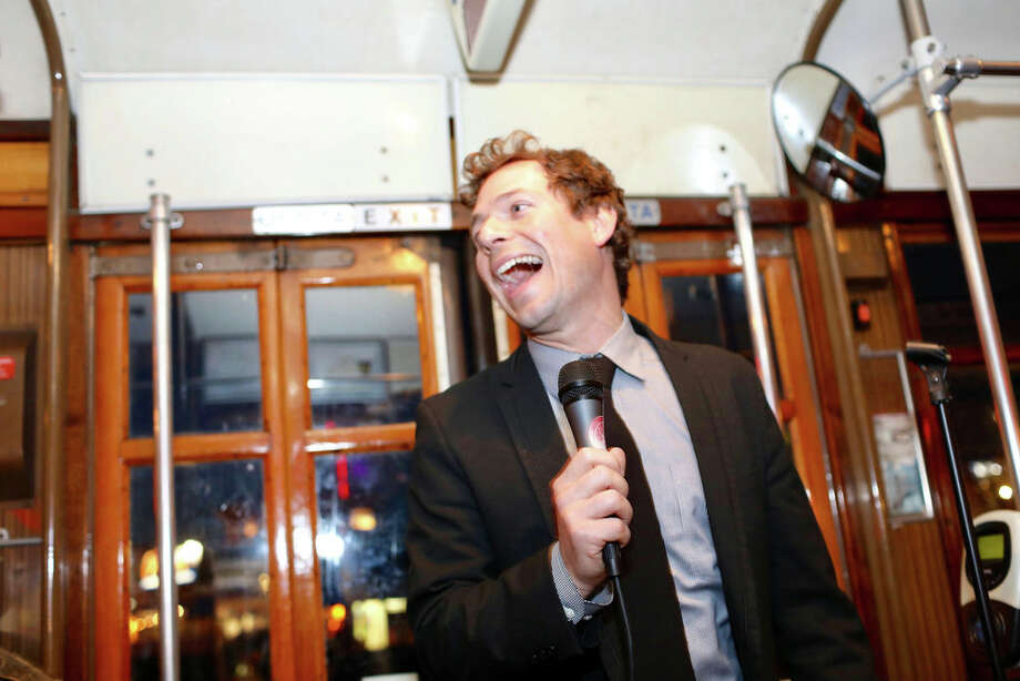 The F Bomb Comedy Train, hosted by Marty Cunnie and Zane Barrett, is a comedy show in motion. Taking place on a historic streetcar, passengers listen to live stand-up while the city moves by in a blur behind the performers. Photo: PJ Crame Https://pjc.photoshelter.com/