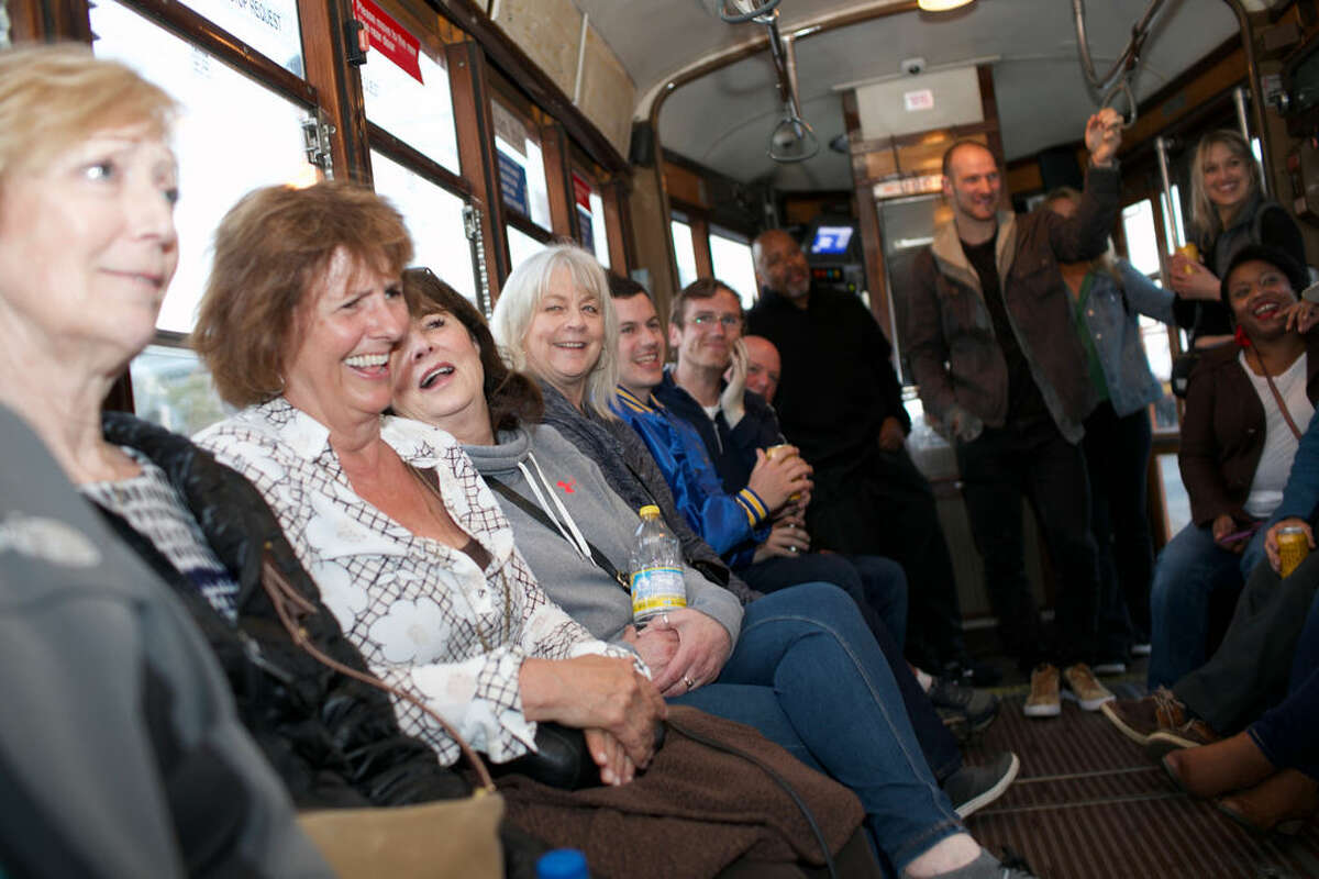 The F Bomb Comedy Train, hosted by Marty Cunnie and Zane Barrett, is a comedy show in motion. Taking place on a historic streetcar, passengers listen to live stand-up while the city moves by in a blur behind the performers.
