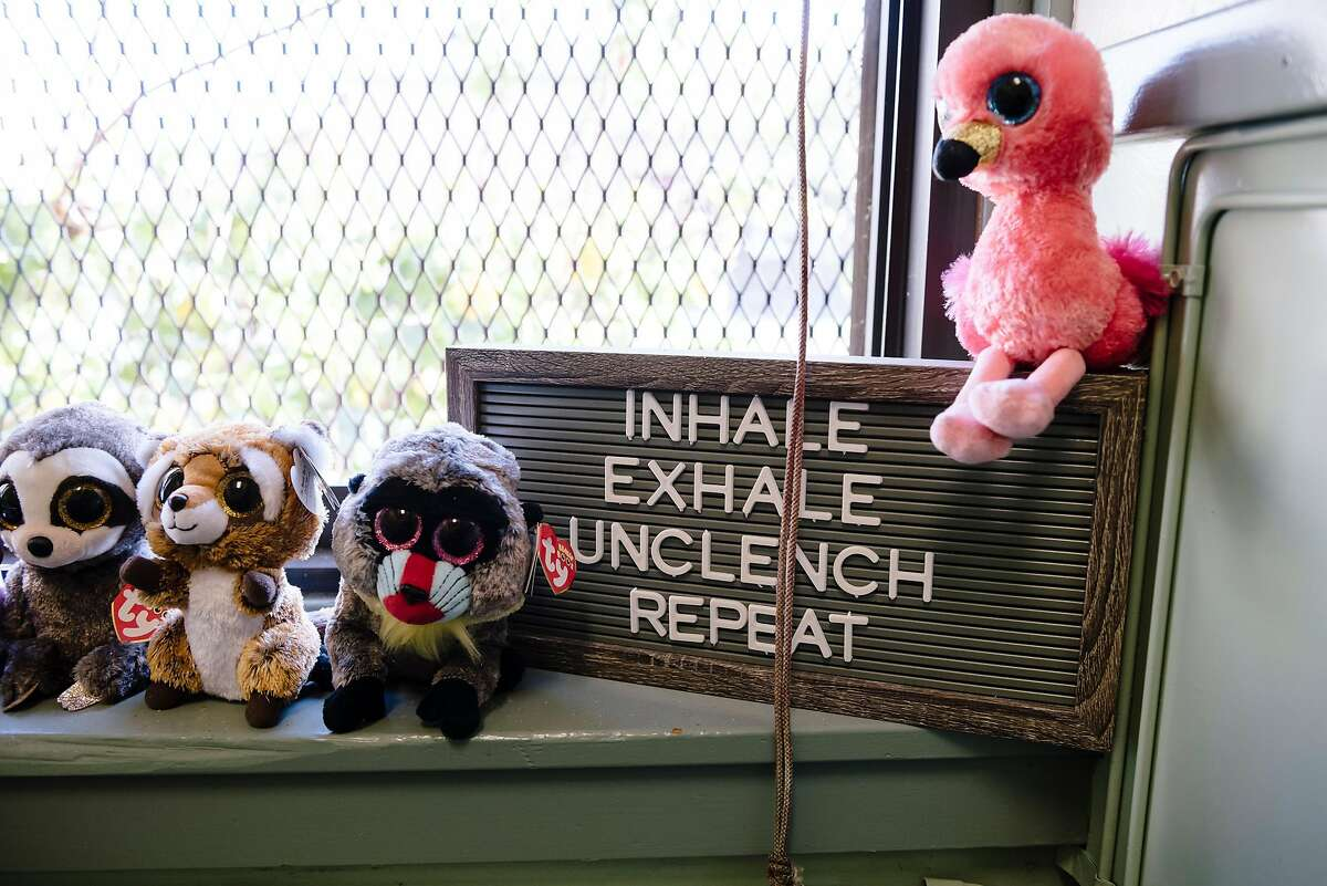Stuffed animals sit next to an inspirational sign in the office of Rosalind Kingsley-Hurst, a Wellness Together mental health specialist at Coliseum College Preparatory Academy in Oakland, California, Monday, November 18th, 2019. Blue Shield of California has launched a new $10 million program for Oakland, San Leandro, and San Diego Unified School Districts that will pay for 19 mental health clinicians at area schools for the next 5 years.