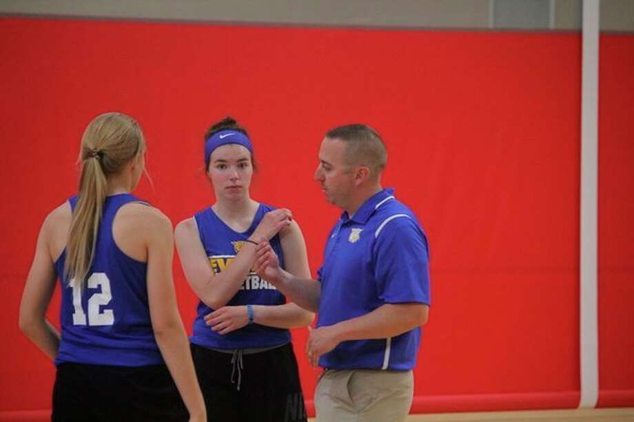 Evart girls coach Matt Tiedt talks to his players during a summer season practice. (Pioneer file photo)
