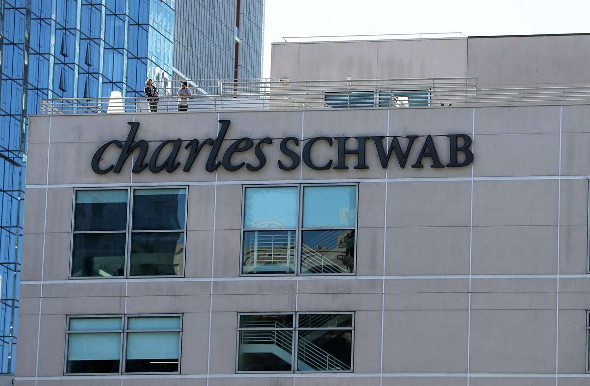 SAN FRANCISCO, CALIFORNIA - NOVEMBER 25: Workers stand on a rooftop deck at a Charles Schwab office on November 25, 2019 in San Francisco, California. Brokerage firm Charles Schwab announced plans to buy rival firm TD Ameritrade for $26 billion. (Photo by Justin Sullivan/Getty Images)