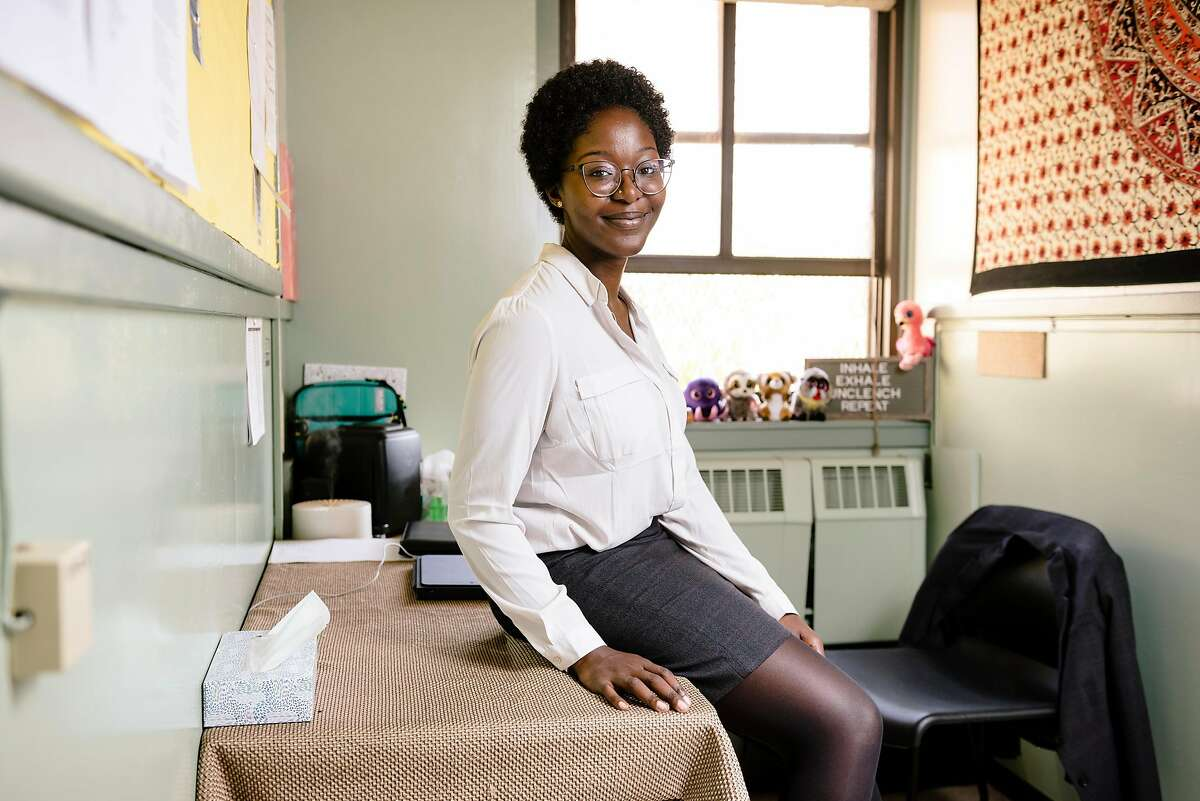 Rosalind Kingsley-Hurst, a Wellness Together mental health specialist, sits for a portrait in her office at Coliseum College Preparatory Academy in Oakland, California, Monday, November 18th, 2019. Blue Shield of California has launched a new $10 million program for Oakland, San Leandro, and San Diego Unified School Districts that will pay for 19 mental health clinicians at area schools for the next 5 years.