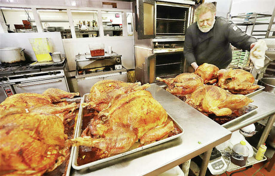 Ken Jaskiewicz, executive chef at Premier Best Western in Alton, brings the first eight turkeys out of the ovens Monday in preparation for the annual Thanksgiving Day buffet 10:30 a.m. through 1:30 p.m. Thursday. In all, the chef will cook 24 turkeys for this year's event.