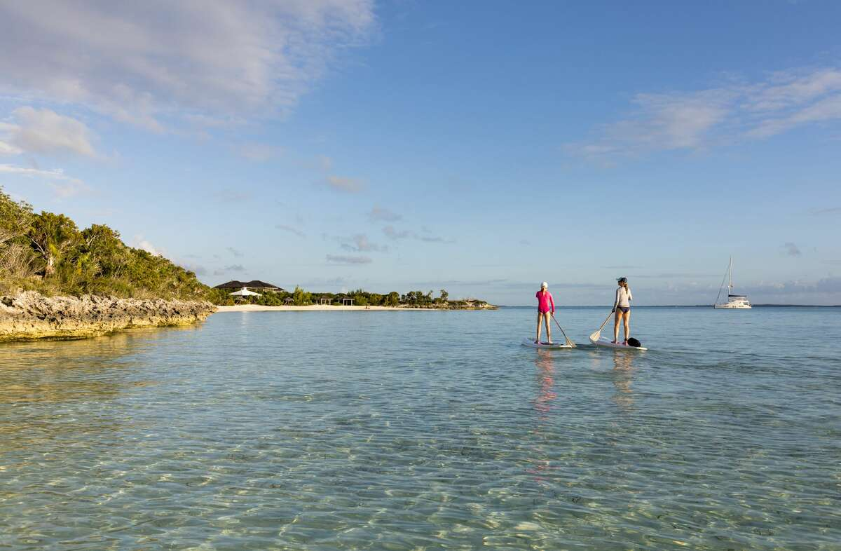 Stand up paddle boarding by Lumina Point, Stocking Island, Exumas, Bahamas.